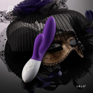 Purple Hand Held Dildo ( with mask in the background)