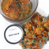 Reciprocitee body balm. Calendula infused for relief to cracked heels, knuckles, elbows, and knees. Made with pure argan oil, jojoba oil, and candelilla wax.