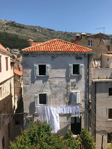 Old building with white laundry handing outside.