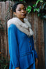Woman wearing 1960s blue fur cardigan.