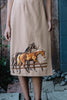Details of 70s tan wrap midi skirt with horses on it.