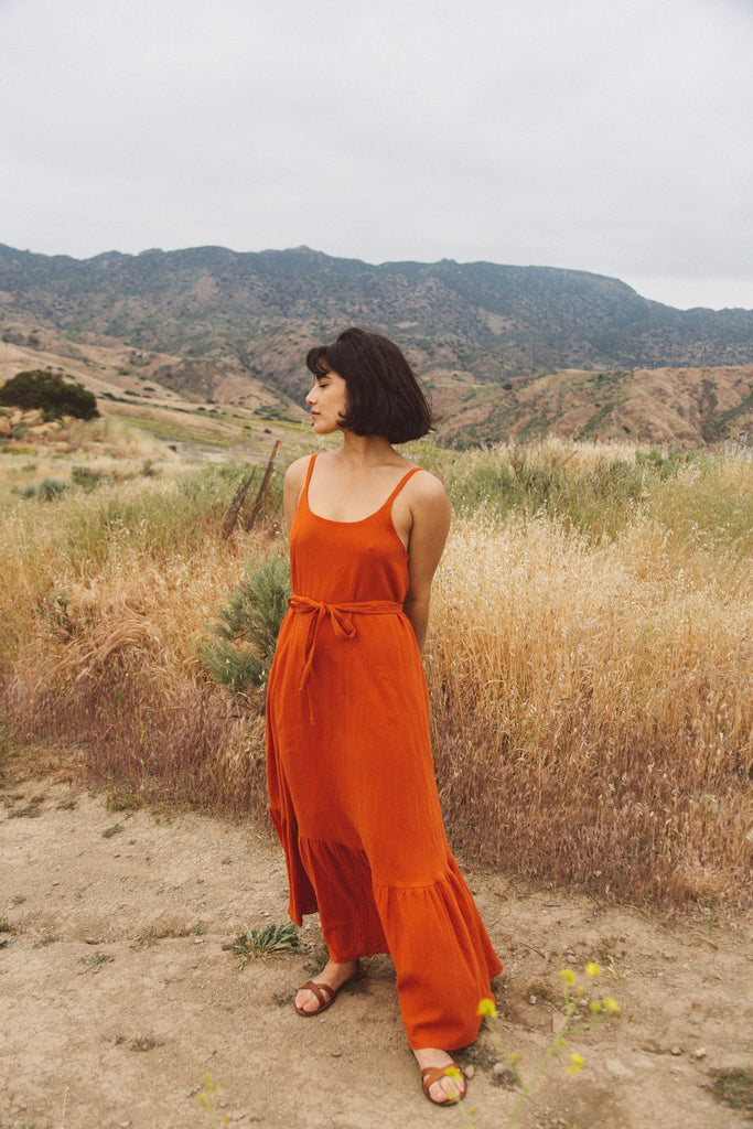 Woman wearing rust orange maxi dress