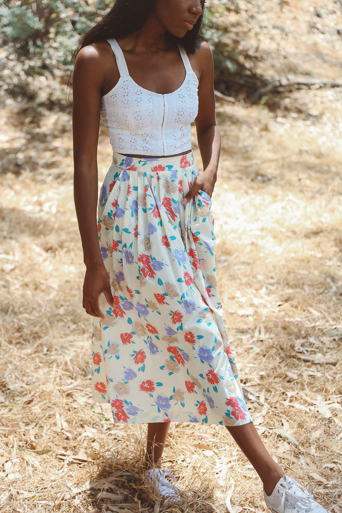 Woman wearing floral midi skirt