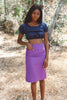 Woman wearing purple pencil skirt