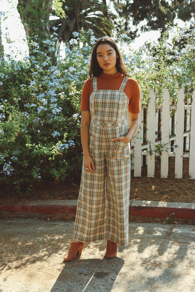 woman wearing sage plaid jumpsuit