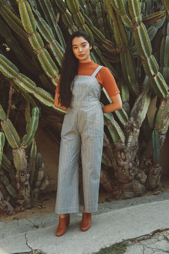 Woman wearing chambray striped denim jumpsuit