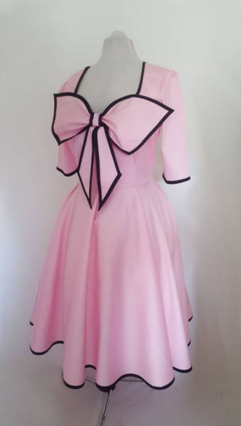 Pink tea length swing dress with sleeves | Pink 50s circle dress with bow | Fullilove Designs