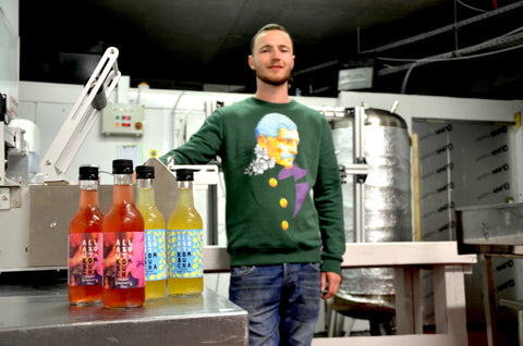 Keith from All About Kombucha wearing Guardian by Grey and Ginger on a green sweatshirt