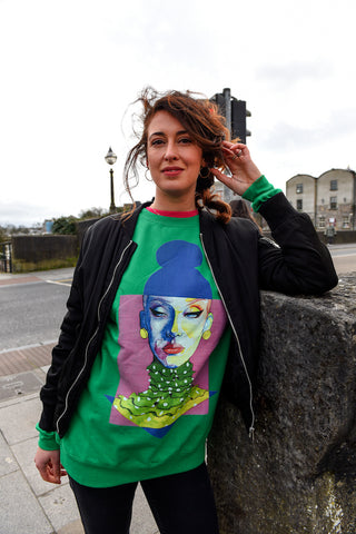 Jess wearing a green La Belle Epoque sweatshirt from Grey and Ginger (photo by Boyd Challenger)