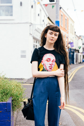 Erin from Paper Mache Mind modelling Warrior on a black relaxed fit T Shirt