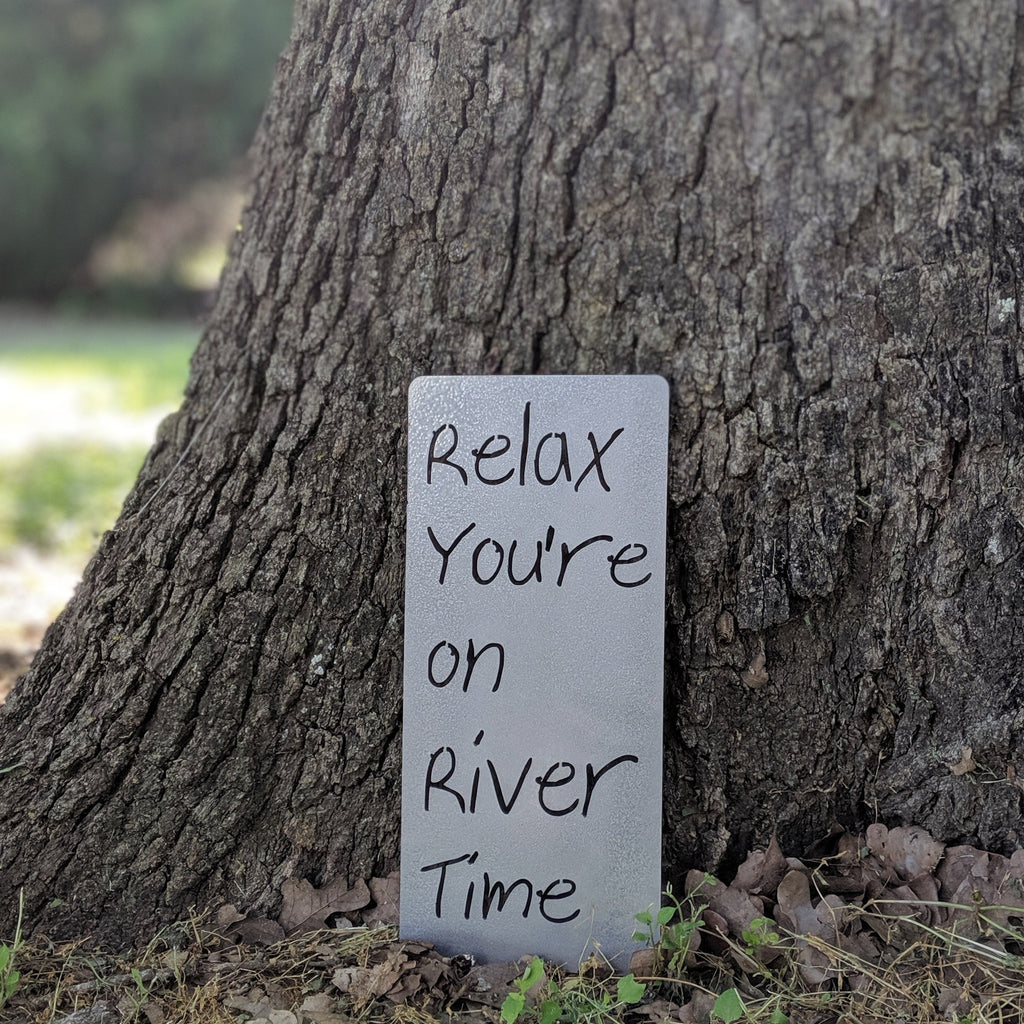 Relax you're on river time metal sign