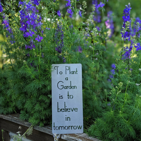 To plant a garden is to believe in tomorrow metal sign