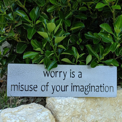 Worry is a misuse of your imagination metal sign