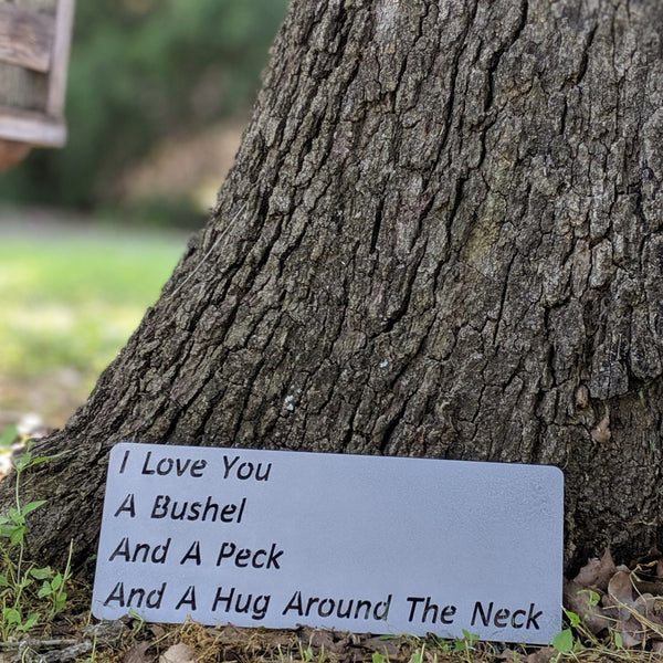 I love you a bushel and a peck and a hug around the neck metal sign