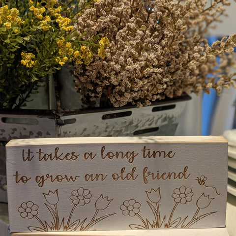 It takes a long time to grow an old friend engraved sign