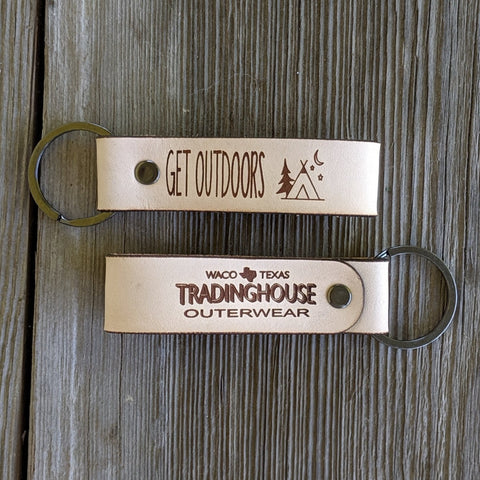get outdoors tradinghouse outerwear logo adventure awaits tent camping leather keychain