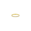 White diamond and gold eternity band ring