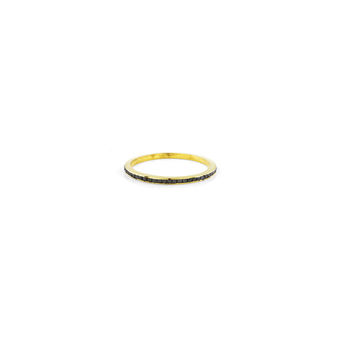 Black diamond and gold channel band ring