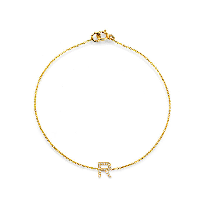 Image of pave diamond and gold initial bracelet.
