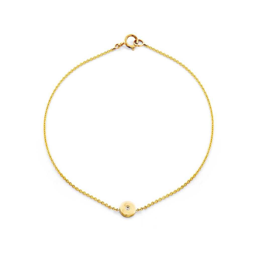 Image of a gold & diamond evil eye bracelet.