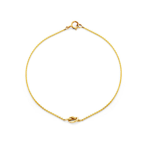 Image of a gold love knot bracelet.