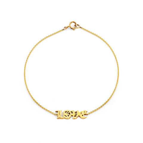 Image of a gold old english love bracelet.