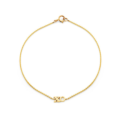 Image of a gold xo bracelet.