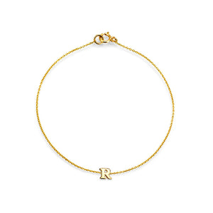 Image of 14k solid gold initial bracelet.