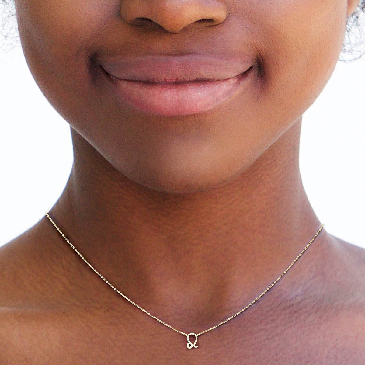 Image of Leo Diamond Zodiac Necklace on Woman's Neck