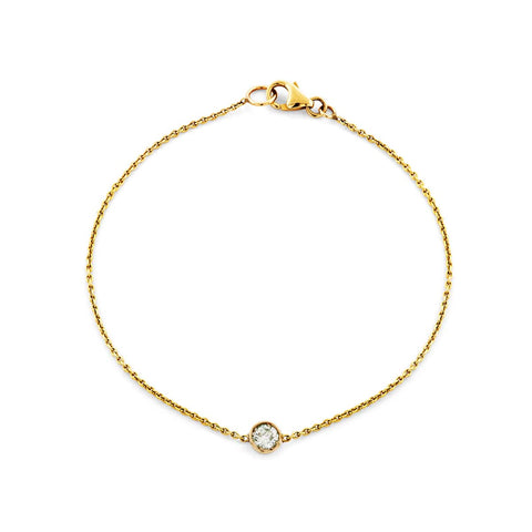 Image of a round cut diamond & gold bracelet.