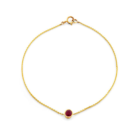 Image of a round cut ruby & gold bracelet.