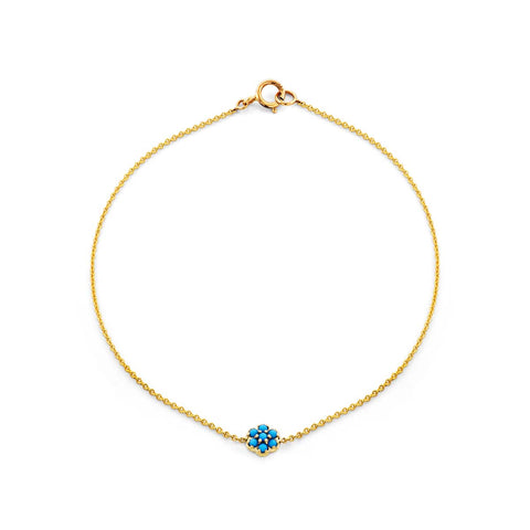 Image of a turquoise flower & gold bracelet.