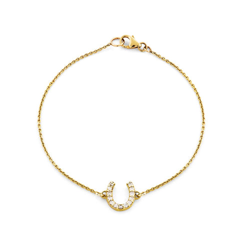 Image of a white diamond & gold horseshoe bracelet.