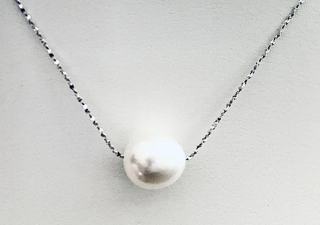 "Single Pearl  strung on 18"" Sterling Silver chain"