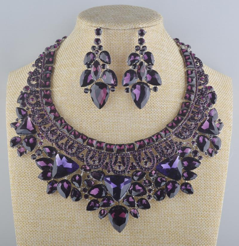 Luxury rhinestone crystal necklace and earrings pageant set in purple.