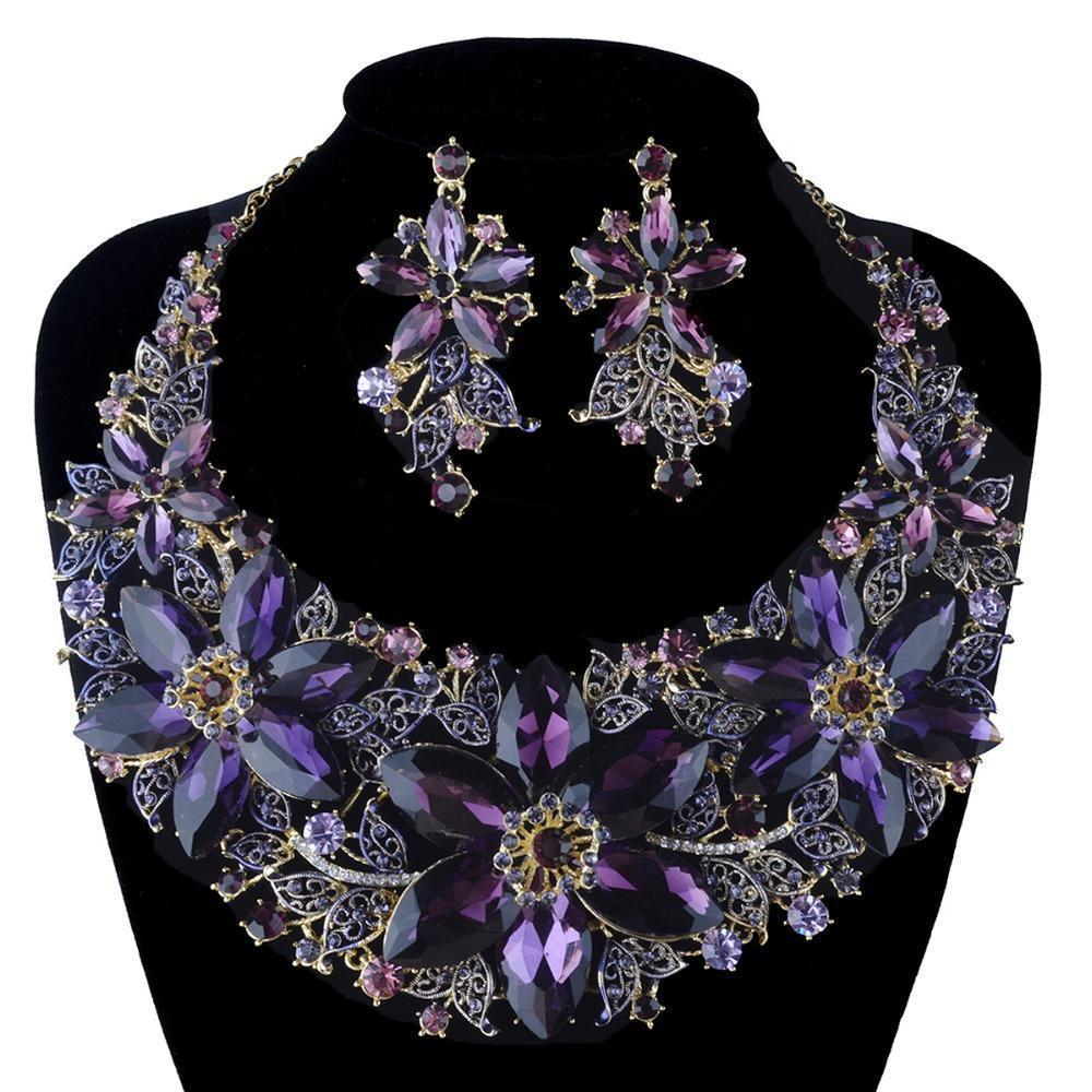Luxury floral crystal necklace and earrings pageant set in purple.