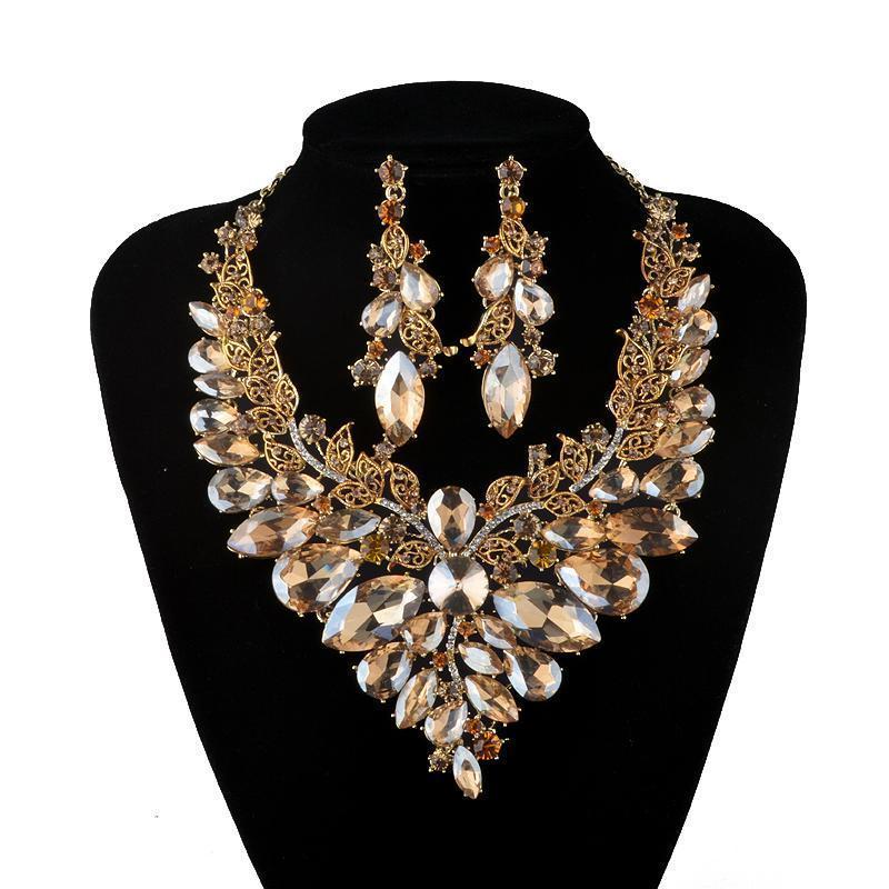 Luxury rhinestone crystal necklace and earrings pageant set in gold.
