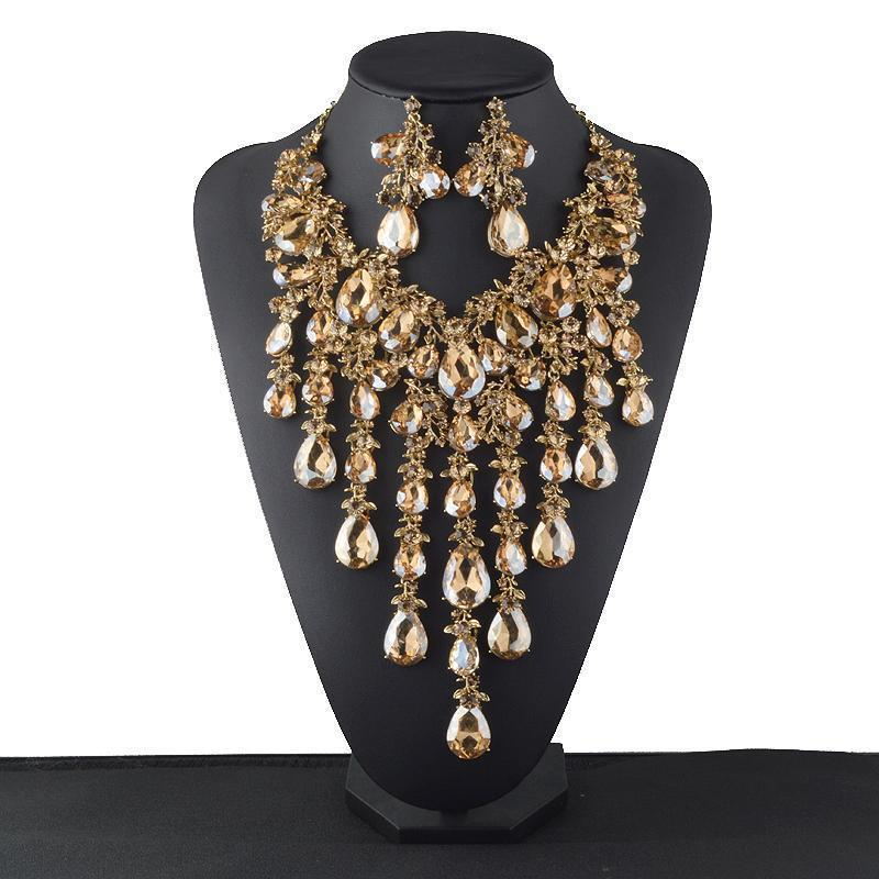 Luxury rhinestone crystal necklace and earrings pageant set in gold and green.