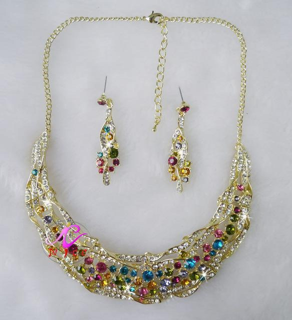 Luxury rhinestone crystal necklace and earrings pageant set in brown, pink, green, blue, multi and more.