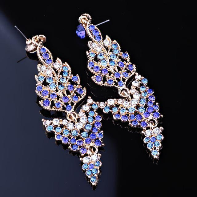 Long pageant earrings in red, blue, green, silver and more.