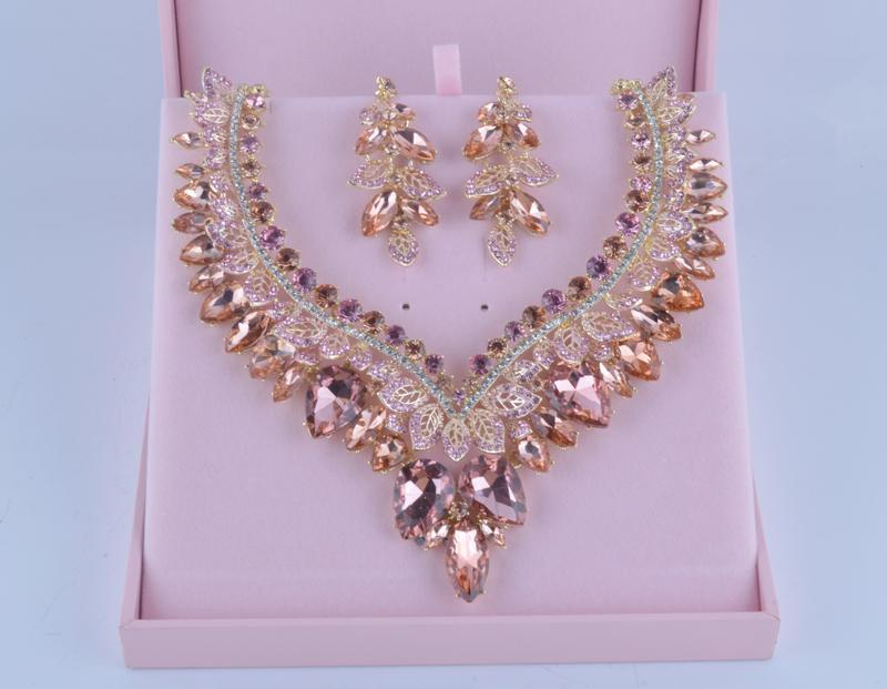 Luxury crystal necklace and earrings pageant set in rose gold.