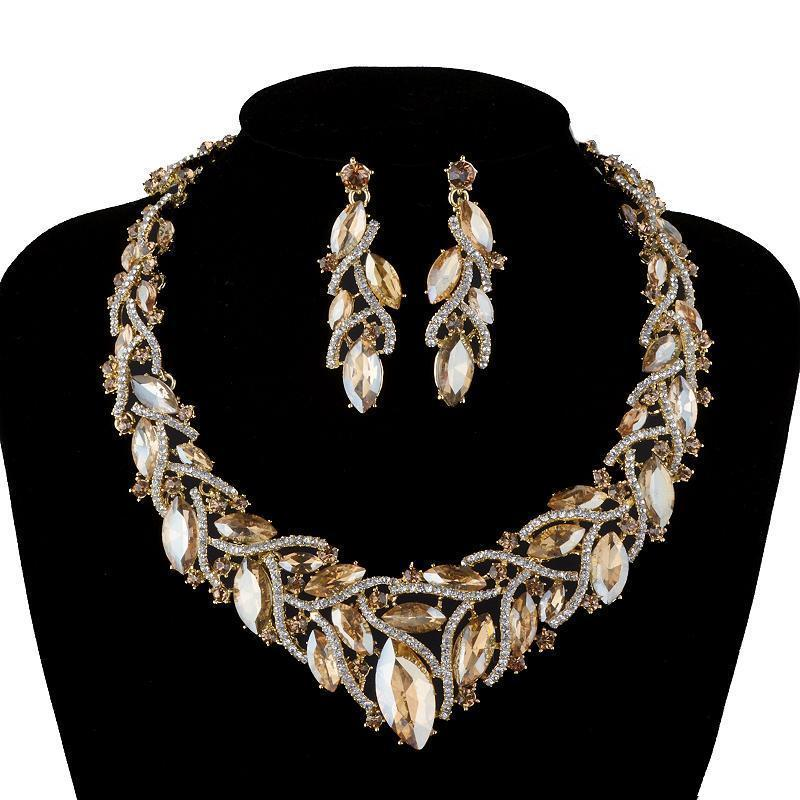 Luxury rhinestone crystal necklace and earrings in champagne.