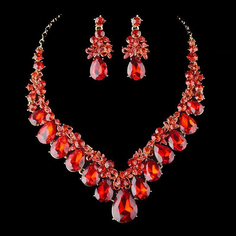 Luxury crystal necklace and earrings pageant set in red.