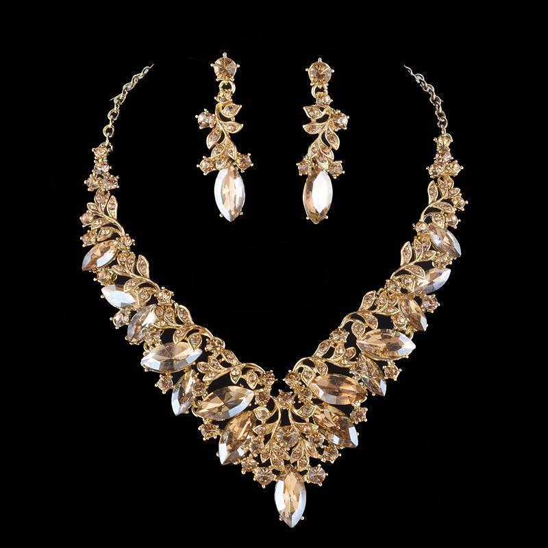Luxury crystal necklace and earrings pageant set in champagne.