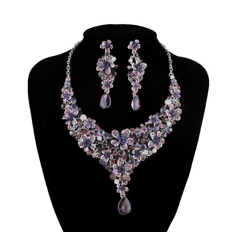 Luxury crystal necklace and earrings pageant set in purple, green, black, red, silver and more.