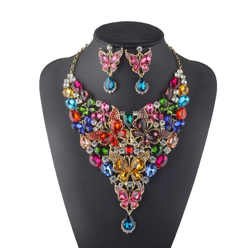 Luxury rhinestone crystal necklace and earrings pageant set in multi, purple and pink.