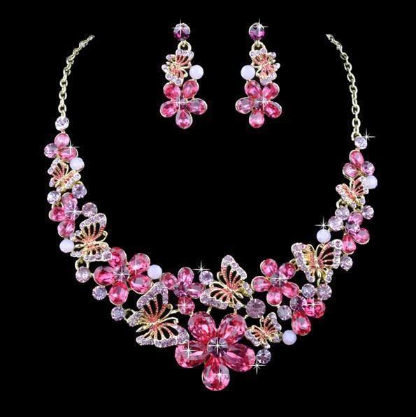 Luxury crystal necklace and earrings pageant set in green, pink, multi, silver and more.