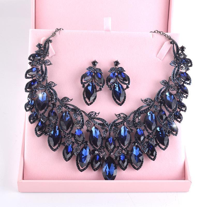 Luxury rhinestone crystal necklace and earrings pageant set in blue. - jovani-dress