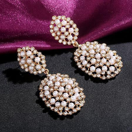 Pearl prom and pageant earrings in silver and gold.