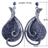 Large pageant earrings in blue, silver, purple and more.